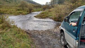 3-van-crossing-stream-mouth-of-valley